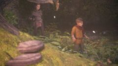 a young boy standing in a garden
