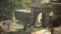 a giraffe standing next to a stone wall
