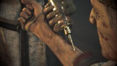 a hand holding a knife