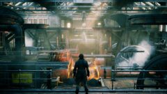 a man standing in front of a factory