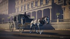 a person riding a horse drawn carriage in front of a building