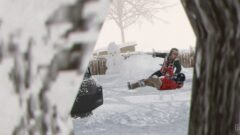 a person riding a snow board in the air