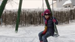 a person wearing a hat with snow on the ground