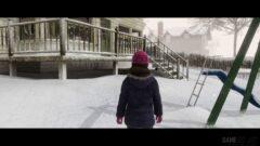 a person riding skis down a snow covered bridge