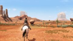 a person riding a horse in a dirt field