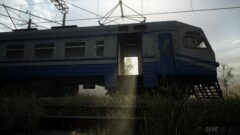 a train that is sitting in the grass