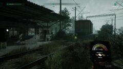 a train traveling down train tracks near a building