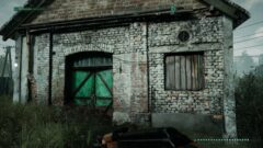an old brick building with a green door