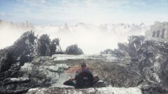 a person sitting on a rock in the snow