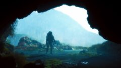 a man standing in front of a mountain
