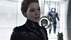 Lea Seydoux standing in front of a mirror posing for the camera