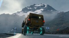 a truck with a mountain in the snow
