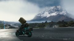 a person riding a motorcycle on the side of a mountain