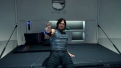 Norman Reedus standing in front of a computer