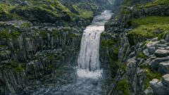 a large waterfall over a rocky cliff
