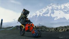 a man riding a motorcycle with a mountain in the background