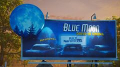 a blue sign in front of a television
