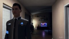 Bryan Dechart wearing a suit and tie standing in a room