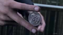 a close up of a hand holding a coin
