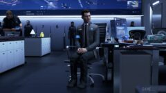 Bryan Dechart standing in front of a computer