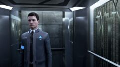 Bryan Dechart standing in front of a mirror posing for the camera