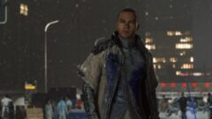 Jesse Williams standing in front of a building