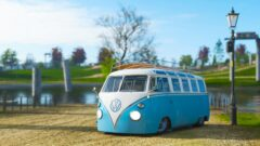 a blue bus parked on the grass