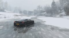 a car driving down a snow covered road