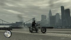 a person flying through the air while riding a motorcycle on a city street