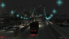 a street filled with traffic at night