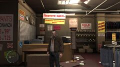 Niko Bellic standing in front of a store
