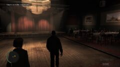 a man in a dark room