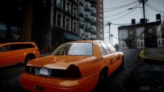 an orange car parked on the side of a building