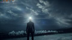 a man that is standing in the dark clouds