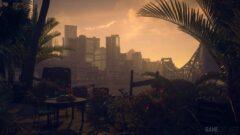 a view of a city next to a palm tree