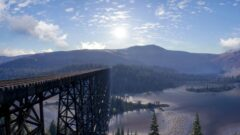 a bridge over a body of water with a mountain in the background