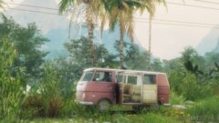 a small truck parked in front of a palm tree