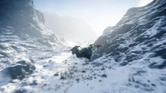 a man riding on top of a snow covered mountain