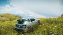 a car parked in a grassy field