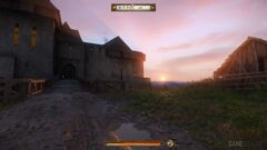 a castle like building with a sunset in the background