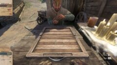 a man sitting on a wooden bench