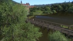 a large long train on a bridge over a river