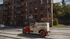 a truck is parked in front of a brick building