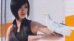 a woman holding a bird
