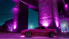 a purple car parked in front of a stage