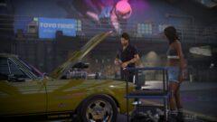 a man standing next to a car