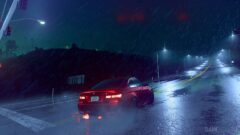 a car stopped at a traffic light on a rainy night