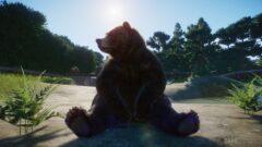 a large brown teddy bear sitting on a ledge