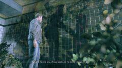 a man standing next to a net