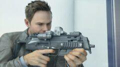 Shawn Ashmore holding a gun